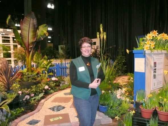 Me in 2010 at the CT Flower Show as a CT Hort Society Volunteer.  Don't you just love the green vest!  Their display won awards, every year at this show!!