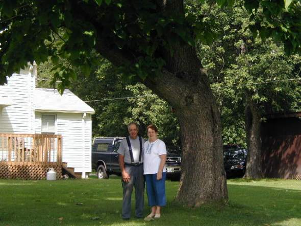 Mom and Dad under a Catalpa Tree at the Farm