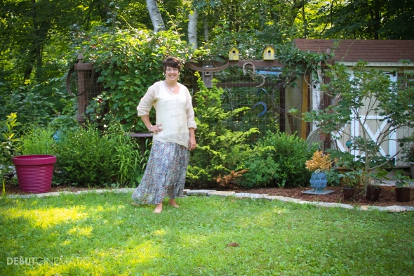 Cathy T in-front of her chicken coop and plants at her home in Broad Brook, CT