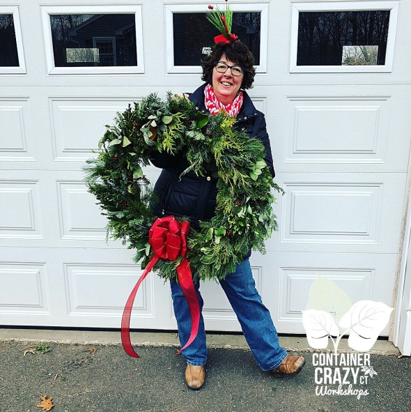 Cathy T Holding Large Wreath
